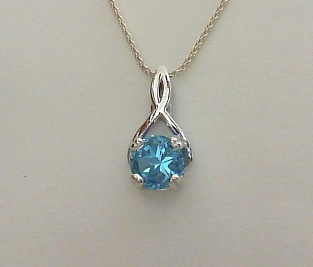 Blue Lone Star Cut topaz in sterling silver Ribbon pendant