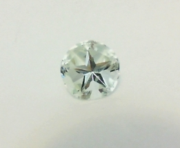 Light green amethyst or prasiolite cut in Lone Star Cut