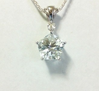Mason County topaz Pentagon with Lone Star Cut. 10.5 mm. Sparkling, crisp natural Texas topaz is faceted with the Lone Star Cut in a pentagon, ...