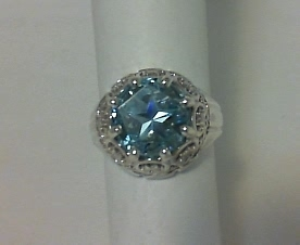 Scroll/filigree ring with blue Lone Star Cut topaz