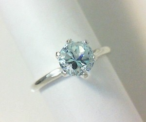 Light blue Lone Star Cut topaz solitare ring