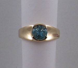 Ring with medium blue Lone Star topaz in yellow gold.