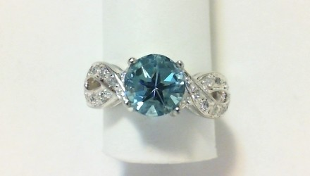 Blue topaz and sparkling CZ's intertwined in silver